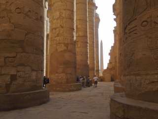 Tourists of the Karnak Temple among the giant columns