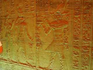Figures on the stone inside the temple of Isis