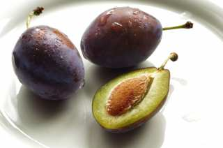 Plum with a bone on a plate