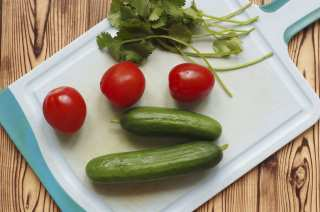 Board with cucumbers and tomatoes