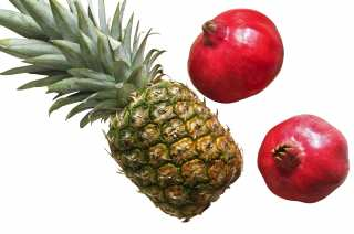 Pineapple and pomegranates on a white background