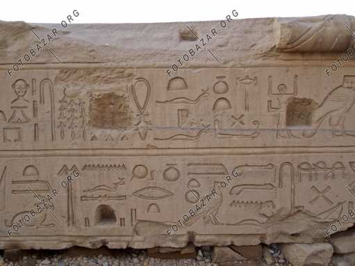 The inscriptions on the stone slab in the Egyptian temple