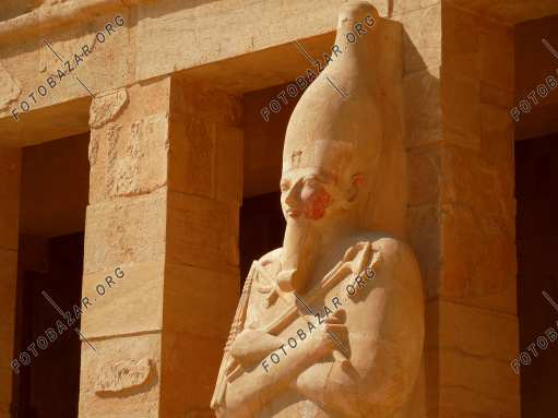 The woman is a pharaoh. Hatshepsut Temple